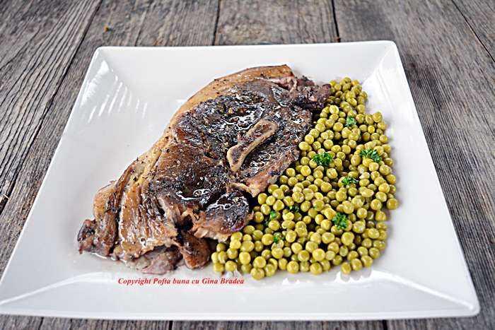 Friptura de porc la tava reteta traditionala pofta buna cu gina bradea 700x467 - Friptura inabusita de porc la cuptor