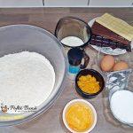 Gogosi pufoase la cuptor, cu glazura de ciocolata sau zahar pudra